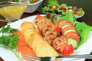 Shish kebab, fried potato rings, cucumber, tomato - delicious food
